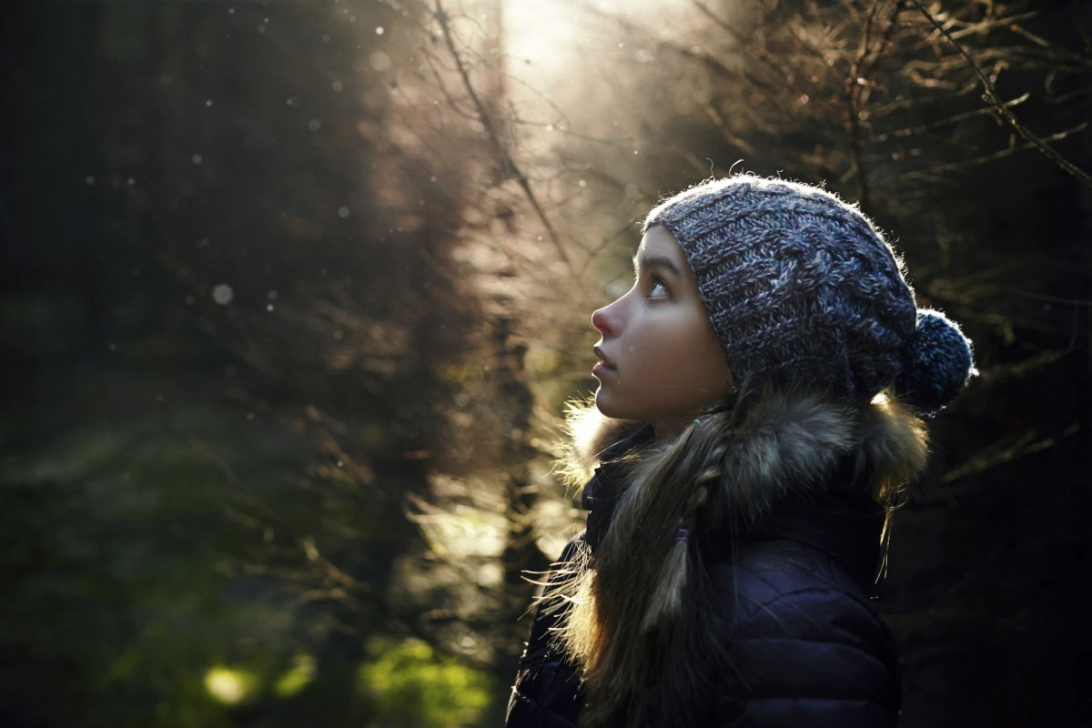 Profile of Caucasian teenage girl in forest